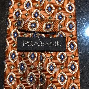 JoS A Bank tie. Rust and blue color